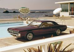 1968 Mercury Cougar, driven right to the edge of a pool for some reason