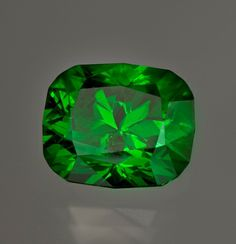 Demantoid - Gem Gallery - Smithsonian Institution  At 11.24 carats it is a major upgrade for the National Gem Collection.  It is a world-class gemstone and one of the largest and finest faceted demantoids known.  The Smithsonian was able to acquire this exceptional gem with funds from the Smithsonian Gemstone Collectors group in 2011.
