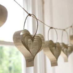Old book pages made into a heart garland. 1 inch strips? and a stapler and wire?