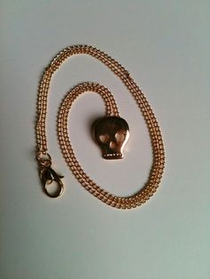 Tiny Gold Skull Pendant Necklace on Thin Gold by aRadboutique, $6.99