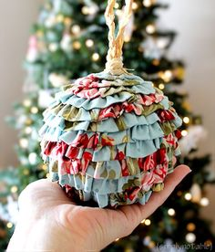 DIY Ruffled Fabric Christmas Ornaments  That's it.  My living room tree is going shabby!