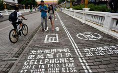 Texting While Walking? In China, There's A Lane For That Walk this way: A Chinese city has installed a special sidewalk lane for distracted walkers.