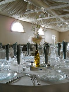 These centerpieces were so cool!  Wine bottles with twinkle lights inside and flowers out the top!
