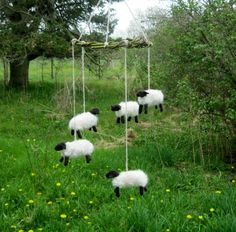 This mobile has five little wool sheep. Babies enjoy looking at black and white contrast so these little wooly friends should be very interesting. Mobiles are great to have above cribs and changing tables to distract a cranky baby. The sheep are hand felted from locally sourced wool over a wire armature. They are suspended on hand spun yarn tied to a handwoven willow wreath. The willow grows well on my farm. This piece measures 20 long and 9 across.  This is not intended as a toy. It is for…