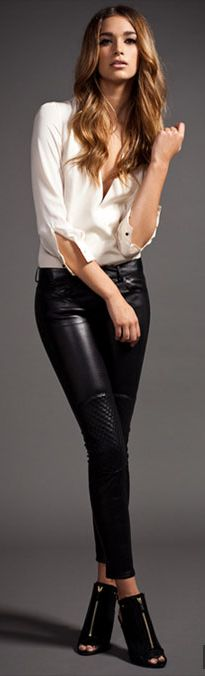 White shirt & black leather leggings.