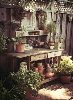 Who's got some gardening on their plans this weekend? This little potting table is simply precious don't you think?