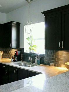 I love the black cabinets and the gray subway glass tile with the white grout but want the long sleep handles