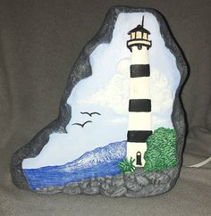 Items similar to Light up Lighthouse Beach Scene Rock Hand Painted Ceramic on Etsy Easy Flower Painting, Rock Painting Ideas Easy, Diy Painting, Rock Painting Patterns, Rock Painting Designs, Paint Designs, Stone Crafts, Rock Crafts, Ceramic Painting