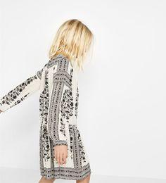 Flowing border print dress