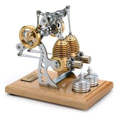 A clever German engineer called Hermann Böhm has been making miniature Stirling engines for 15 years now. They run on spirit and are made of the same materials as the real thing, and with the same care and precision. We offer here two of his most impressive models – all the parts are of brass, aluminium or stainless steel  - in two versions....