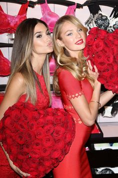 Lily Aldridge and Candice Swanepoel don slinky red outfits for the Victoria's Secret Angels Valentine's Day Event in New York