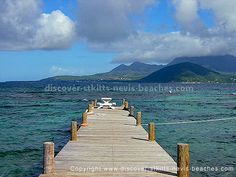 Jetty at Turtle Beach in St. Kitts. Nevis in the background across the channel.