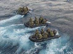 Marines attached to the 31st Marine Expeditionary Unit (MEU) depart the well deck of the forward deployed amphibious transport dock ship USS Green Bay (LPD 20) in combat rubber raiding crafts (CRRC). Mil-Mall.com