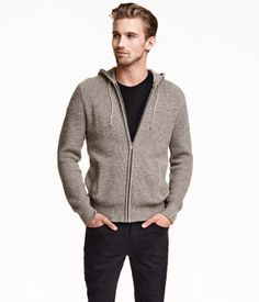 Ribbed cotton jacket with a jersey-lined drawstring hood, concealed zip at front, and side pockets.