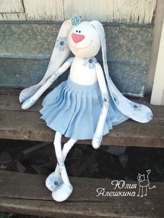 bunny doll in blue pleated skirt & printed ears