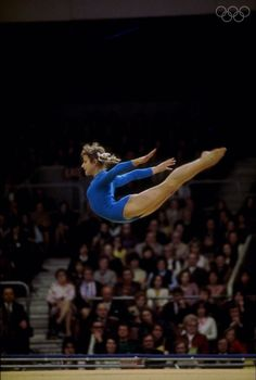 1972: Olga Korbut of the Soviet Union in action during the gymnastics competition at the 1972 Olympic Games in Munich, Germany. The pretty gymnast won gold on the balance beam, the floor exercises and was also a member of the winning all-round team aswell as a silver medalist on the uneven parallel bars. She captured the hearts of the world with her impish style and brilliant smile. Mandatory Credit: Allsport UK/Allsport