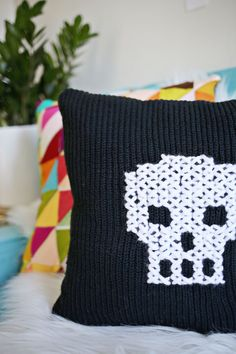 An old sweater becomes a new skeleton pillow in this #DIY!