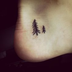 Small tree tattoo. Love the placement. I'd choose a willow tree.