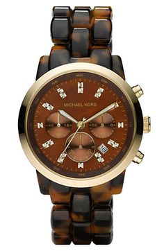 Free shipping and returns on MICHAEL Michael Kors Michael Kors Resin Chronograph Watch, 40mm at Nordstrom.com. Glittering crystals mark the three-eye chronograph dial of a glamorous watch finished with a matching resin bracelet band.