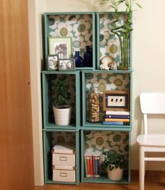 Repurpose old dresser drawers--a little bit of paint can brighten the drawers and line them with wallpaper or contact paper to create interest.  In the photo above, dresser drawers are used as a display/bookcase sitting on the floor.
