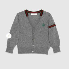 Gucci Merino Wool Cardigan Authentic Gucci Baby merino wool cardigan. Grey ultra fine knit merino wool with green/red/green web detail Long sleeves Interlocking G patch on chest Size 12/18 months. Like new Gucci Accessories