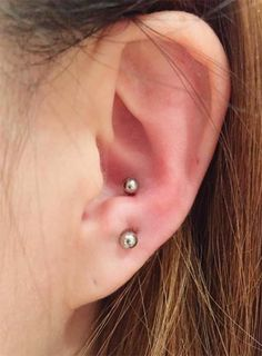 Body Piercing Types, Healing Times and Aftercare Types of Body Piercings: Ear Piercings – Anti-Tragus Piercing More from my site Do Helix Piercing Fit Your Type? types of ear piercings Tragus Piercings, Ear Piercings Chart, Different Ear Piercings, Anti Tragus Piercing, Types Of Ear Piercings, Cute Ear Piercings, Body Piercings, Rare Crystal, Jewelry For Her