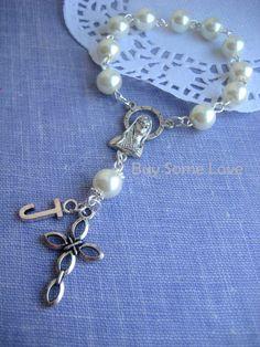 Car rosary, wall hanging.