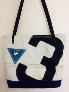 A personal favorite from my Etsy shop https://www.etsy.com/listing/231738526/recycled-sailcloth-tote-reef-point-black