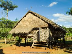 A traditional wooden house in #Laos, boasting impressive patterns on the walls!