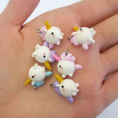 A little handful of magical cuteness :D... another view of the unicorns I finished! I'm so pleased with how these turned out I might have to keep one for myself . . . #unicorns #unicorn #whimsical #magical #unicornjewelry #unicornnecklace #kawaii #cute #polymer #polymerclay #polymerclaycharm #handmade #crafting #etsy #fimo #fimoclay #miniature #mini #crafts