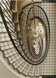 Interior decoration by SR Gambrel interior design firm based in New York. An oval staircase dressed with a geometric runner graces the entry of this New York City townhouse Winding Staircase, Grand Staircase, Staircase Design, Spiral Staircases, White Staircase, Tiled Staircase, Staircase Runner, Stair Runners, Staircase Wit