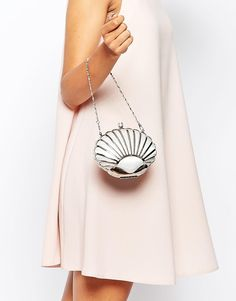 i had to get this.  the ocean was underrepresented in wedding plans so far.  lucky that the style goes with the shoes/dress so i could have a solid excuse.Vintage Styler Shell Clutch in Silver, asos