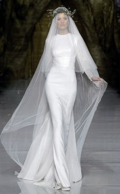 modern wedding dress with traditional veil