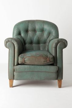 This chair just begs me to put it by a fireplace, grab a throw, a book, and read.