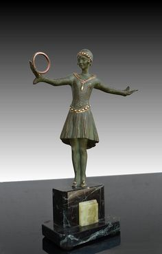 Patinated bronze sculpture of a ring dancer. Signed Grisard in the bronze.