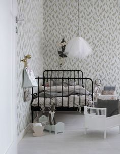 White kids room with pretty wallpaper