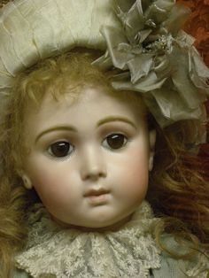 size 14  (collection Odin-Musée de la Poupée-Paris) Jumeau Triste - the doll that made me fall in love with antique reproduction dollmaking in the 1970's. Although close, to this day, I've never been able to quite capture her true delicate beauty for myself.