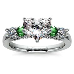 Who doesn't love the shimmering freshness of gorgeous green emeralds alongside sparkling diamonds? 2013's Colour of the Year enhances this piece's Heart-cut center diamond: Discover the Round Diamond and Emerald Gemstone Engagement Ring in sleek Platinum! http://www.brilliance.com/engagement-rings/round-diamond-emerald-gemstone-ring-platinum