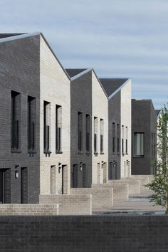 Scottish firm McGinlay Bell used low-cost concrete bricks to create the black and white walls of this canalside housing development in the West End of Glasgow. Brick Architecture, Contemporary Architecture, Brick Detail, Kingdom Hall, Mews House, Concrete Bricks, Black Brick, Social Housing, Urban Planning