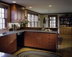 Great kitchen design!  Love the braided rug!