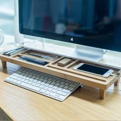 Keep you desk organized with this Wooden Keyboard Rack Organizer. If you have trouble keeping your desk organized like me then this is the perfect item for you. It's handmade with differently shaped and sized compartments so you can keep your items neat.