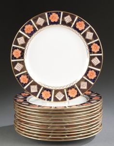 Lot 233: 12 Royal Crown Derby Imari plates. Estimate: $500-$700.