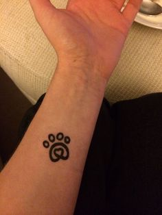 Paw print tattoo    LOVE LOVE LOVE this and U just may get another tatt... like I need another and then there is the question of placement....  Bahahahahahahahahaha