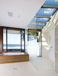 Natural materials and simple design lines are utilized to create a sensual connection to the splendor of the home's location. This subtle transition between interior and exterior was the core philosophy of the design process bringing the outsite into each element of the home. #backsplashinkitchen #kitchenbacksplashmosaic #dyibacksplashkitchen Patio Interior, Interior And Exterior, Modern Interior, Plafond Design, Ceiling Design, Beautiful Bathrooms, My Dream Home, Interior Architecture, Beautiful Homes