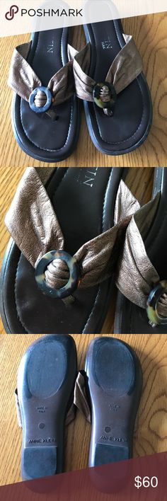 Anne Klein Metallic Flip Flops EUC Super stylish Anne Klein (for Garnet Hill) metallic leather flip flops with tortoise shell accent! Women's size 8 (medium width)... In excellent pre-owned condition! (Only worn about 1/2 dozen times, and name has begun to fade off the footbed, otherwise great!) Comes from a smoke free home. Thanks for looking, and happy shopping! Anne Klein Shoes Sandals