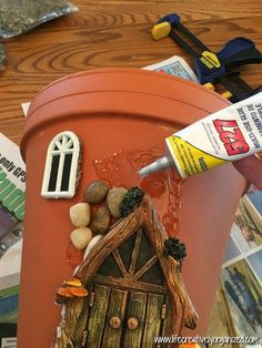 Here's how to make a sweetly whimsical DIY fairy house planter from a terra cotta pot & other inexpensive items. It's really easy, so why not give it a try? # Gardening in pots Whimsical DIY Fairy House Planter - LIFE, CREATIVELY ORGANIZED Fairy Crafts, Garden Crafts, Garden Art, Garden Ideas, Garden Planters, Rock Planters, Fairy Garden Houses, Diy Fairy House, Diy Fairy Door