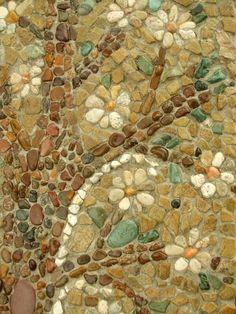Pebble mosaic- over brick wall?