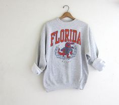 About Vintage Florida Gators Basketball Sweatshirt REW.This Sweatshirt is Made To Order, we print one by one so we can control the quality. We use DTG Technology. Hoodie Sweatshirts, Basketball Sweatshirts, Tumblr Sweatshirts, Vintage Florida, Sweatshirt Outfit, Crew Neck Sweatshirt, Florida Gators Basketball, Florida Gators Hoodie, Sweatshirts