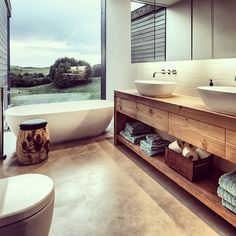 Love the bath and big window at the end. Nice size vanity. Not the placement of the toilet.