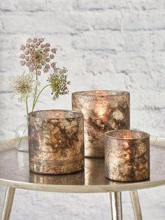 This collection of antique copper hurricanes is perfect for adding some soft lighting to your home.